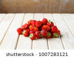ripe strawberries on a wooden...   Shutterstock . vector #1007283121