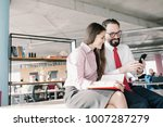 two managers sitting on desk.... | Shutterstock . vector #1007287279