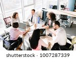 colleagues working in office.... | Shutterstock . vector #1007287339
