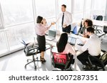 business consultants working in ... | Shutterstock . vector #1007287351