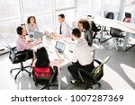 business people sitting at desk ... | Shutterstock . vector #1007287369