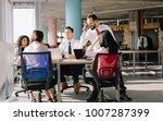 business team sitting in modern ... | Shutterstock . vector #1007287399
