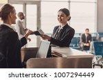 happy businesswoman giving...   Shutterstock . vector #1007294449