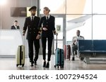 male and female pilots walking... | Shutterstock . vector #1007294524