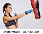 woman smiling beats in boxing... | Shutterstock . vector #1007300305
