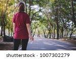 a young asian woman wearing... | Shutterstock . vector #1007302279