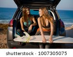 two beautiful surfer girls... | Shutterstock . vector #1007305075