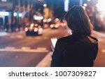 girl pointing finger on screen... | Shutterstock . vector #1007309827