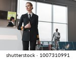 female pilot with suitcase at... | Shutterstock . vector #1007310991