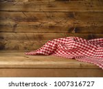 empty wooden table with red... | Shutterstock . vector #1007316727
