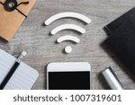 top view of smartphone on desk...   Shutterstock . vector #1007319601