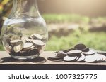 stacking coins and money... | Shutterstock . vector #1007325775