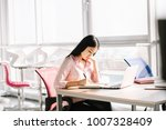 beautiful manager sitting at... | Shutterstock . vector #1007328409