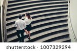 Small photo of Businessman and Business woman go up the stairs Success concept
