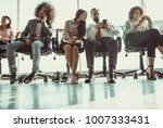 young team of coworkers sitting ... | Shutterstock . vector #1007333431