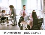 three man and three women in... | Shutterstock . vector #1007333437