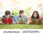 Small photo of Young people studying reading book in park. education study by read.
