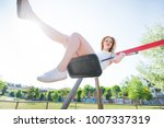 young beautiful woman in a city ... | Shutterstock . vector #1007337319