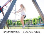 young beautiful woman in a city ... | Shutterstock . vector #1007337331