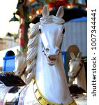 Small photo of white horse carousel
