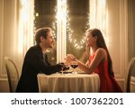 sweet couple celebrate their... | Shutterstock . vector #1007362201