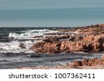 Rough Seas And Jagged Rocks On...