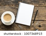 empty notebook and coffee on ... | Shutterstock . vector #1007368915