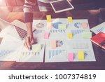 asian business man hand holding ... | Shutterstock . vector #1007374819