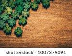green wooden four leaf... | Shutterstock . vector #1007379091