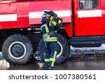 a fireman standing near a red... | Shutterstock . vector #1007380561