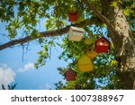 Multicolored Birdhouses On A...