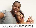 couple selfie. studio shot of... | Shutterstock . vector #1007399359