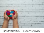 child's hands holding a... | Shutterstock . vector #1007409607
