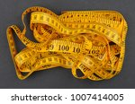 yellow measuring tape  on black ... | Shutterstock . vector #1007414005