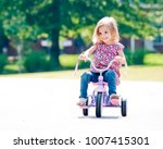 Happy little girl riding a...