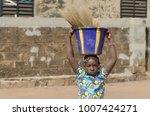 african woman helping her... | Shutterstock . vector #1007424271