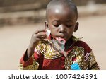 african black boy blowing... | Shutterstock . vector #1007424391
