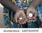 little african girl holding... | Shutterstock . vector #1007424559