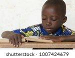 little african boy reading big... | Shutterstock . vector #1007424679