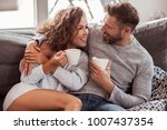 fashion couple is drinking... | Shutterstock . vector #1007437354