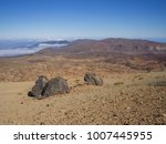 Small photo of desert volcanic landscape on Tenerife with purple mountains in el teide national nature park with Huevos del Teide (Eggs of Teide) accretionary lava balls on clear blue sky background