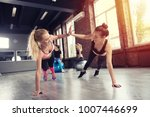 two friend at the gym doing... | Shutterstock . vector #1007446699