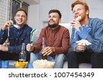 men watching sport on tv... | Shutterstock . vector #1007454349
