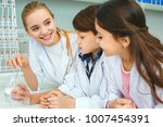 little kids with teacher in... | Shutterstock . vector #1007454391