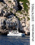 white sailing ship in calanques ... | Shutterstock . vector #1007479801