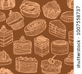 seamless pattern with cupcakes... | Shutterstock .eps vector #1007558737