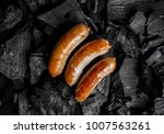 fried meat sausages on a black... | Shutterstock . vector #1007563261