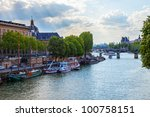 Ships on the river of the Seine, Paris, in a cloudy day. - stock photo