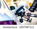 refueling car at gas station.... | Shutterstock . vector #1007587111