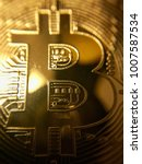 closeup of a golden bitcoin... | Shutterstock . vector #1007587534